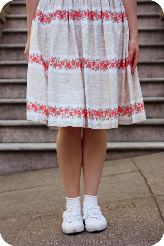 Fifties dress with peach flowers around hem.jpg