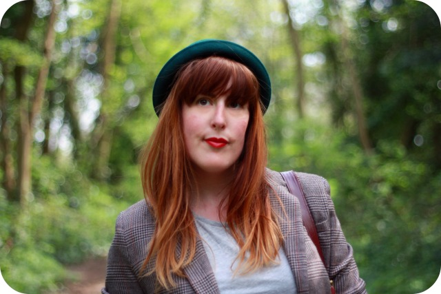 Green bowler hat and tweed blazer