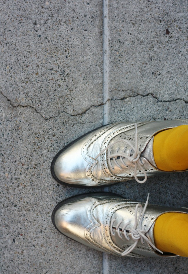 Silver brogues and mustard tights