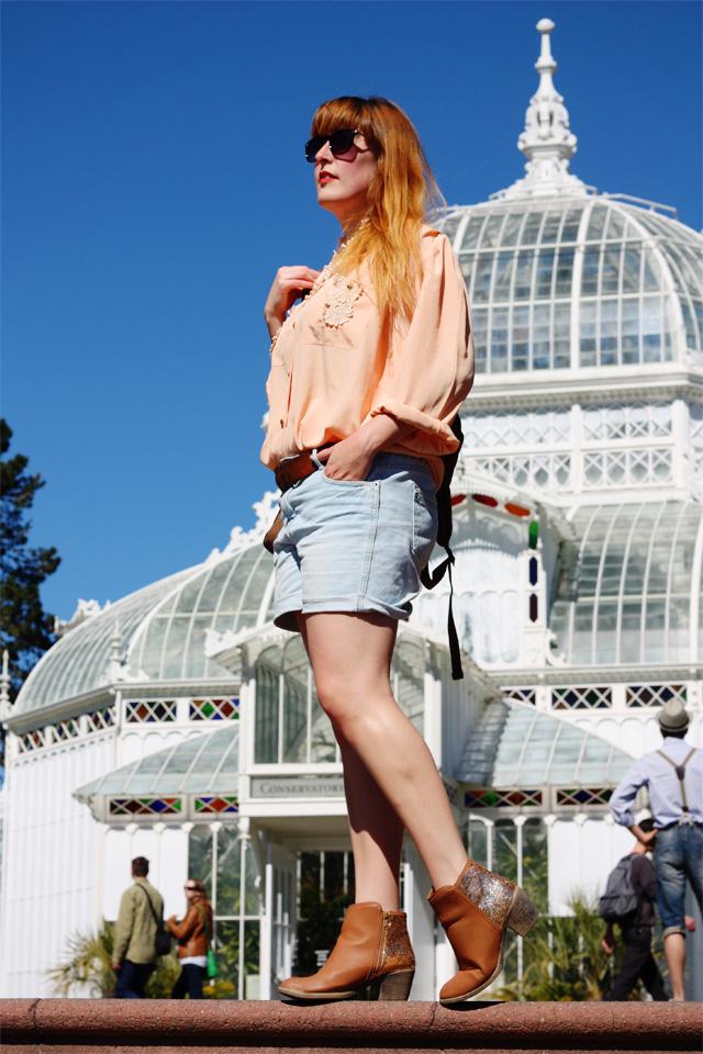 Peach clothes swap shirt and denim shorts