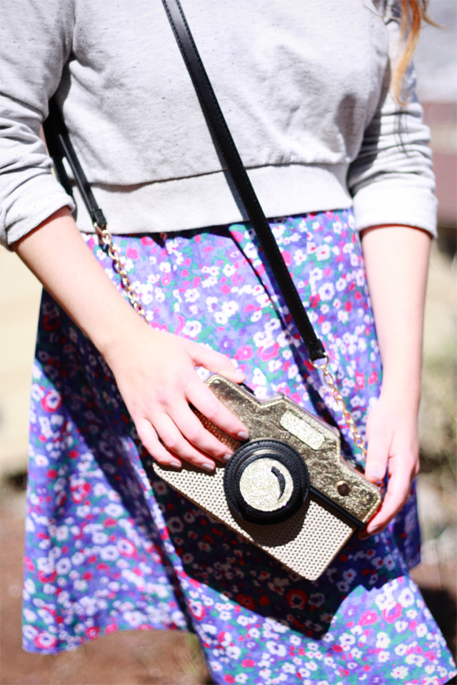 Floral dress and gold camera bag